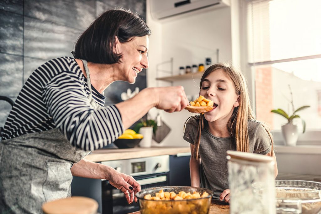 Stock image of grandmother and granddaughter in kitchen
